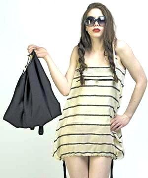 Black wool frock-sac shown as bag